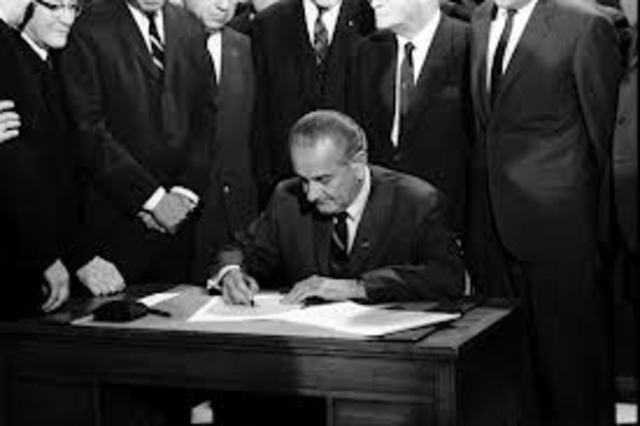 President Johnson signs Civil Rights Act of 1968