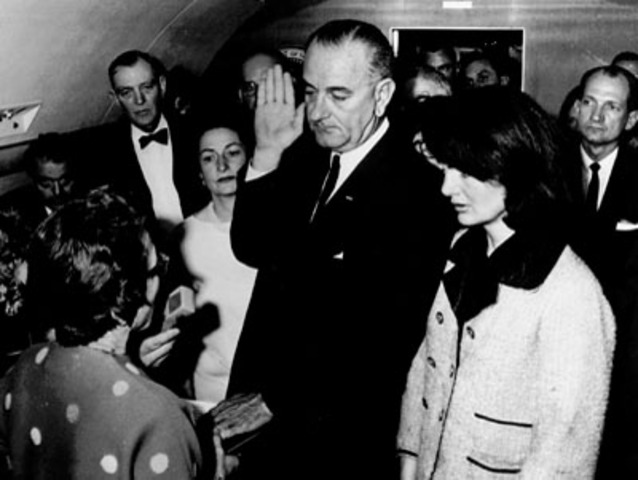 Lyndon Johnson assumes the presidency