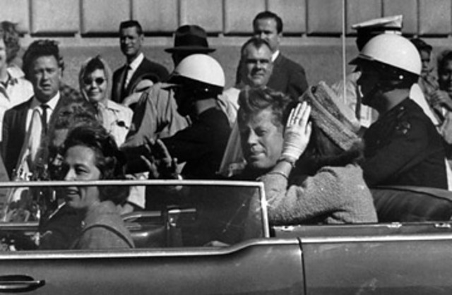 Kennedy is assassinated; Johnson assumes presidency.
