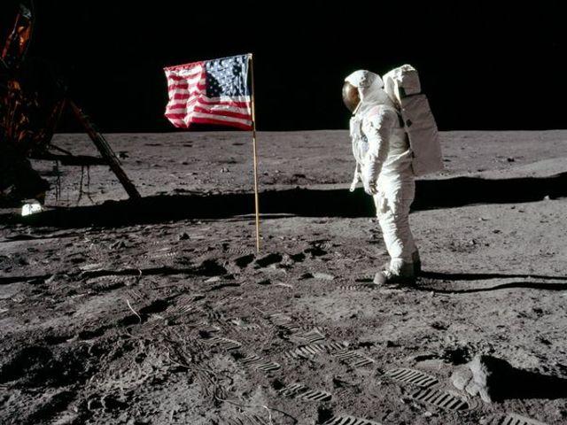 Astronauts land on the moon.