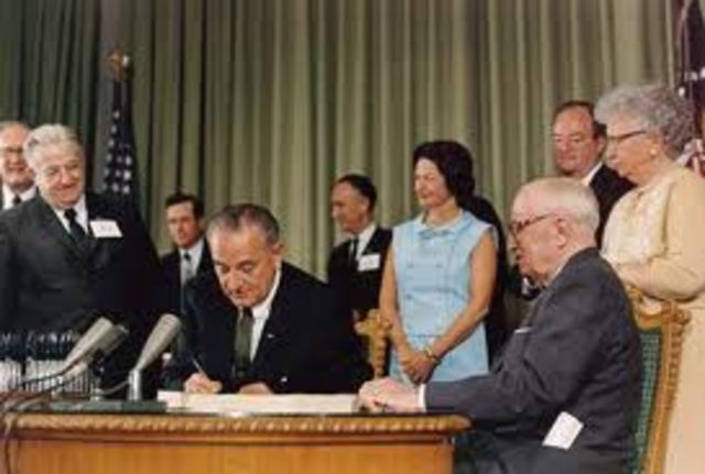 Johnson signs Medicaid and Medicare into Law