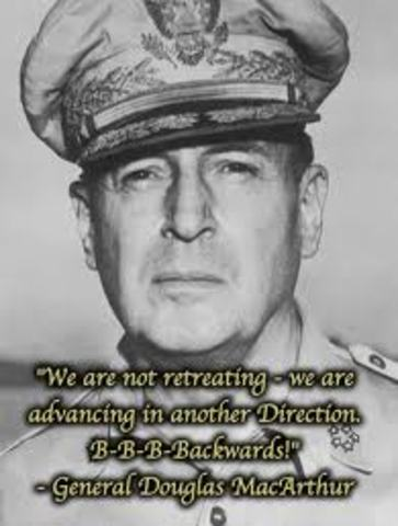 General Douglas MacArthur begins a withdrawal from Manila to Bataan; Japanese take Wake Island
