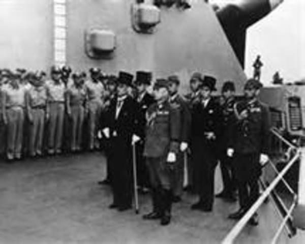 Japanese officials sign an official letter of surrender on the U.S.S. Missouri, ending World War II