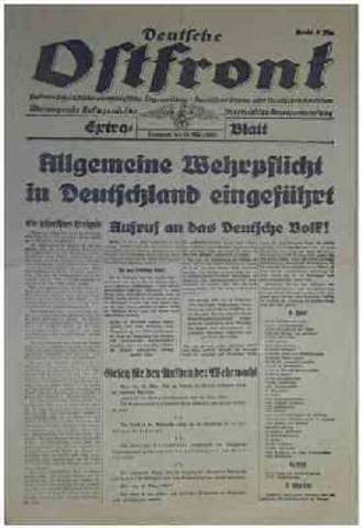 Hitler violates the Treaty of Versailles by introducing military conscription