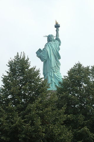 The Statue of Liberty arises in New York
