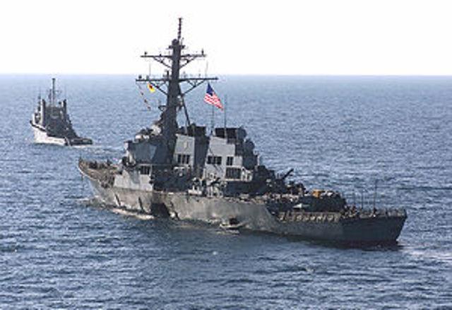 Al Qaeda crashes into USS Cole