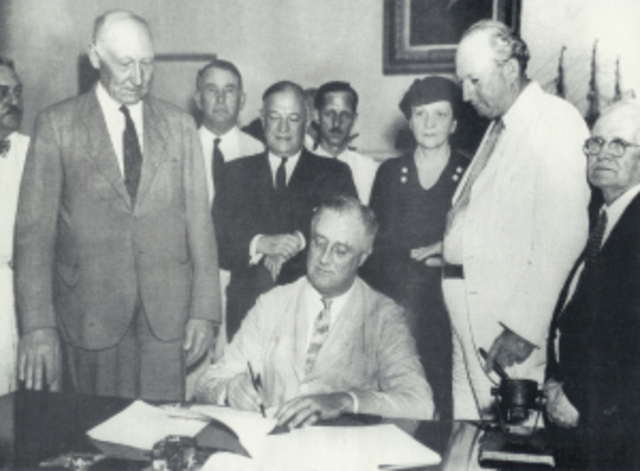 President Roosevelt Signs the Social Security Act