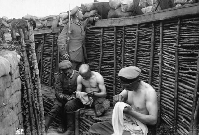 Soldiers Picking Lice From Clothes