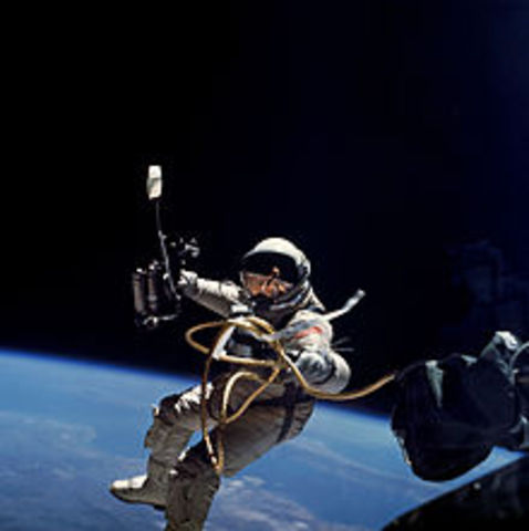 Ed White performs America's first spacewalk.