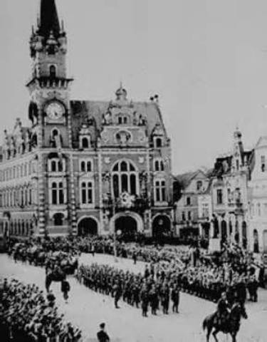 German troops occupy the Sudetenland; Czech government resigns.