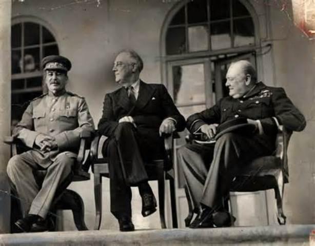 Roosevelt, Churchill, Stalin meet at Teheran.