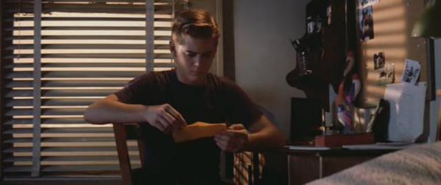 Ponyboy found the letter Johnny left.(1)
