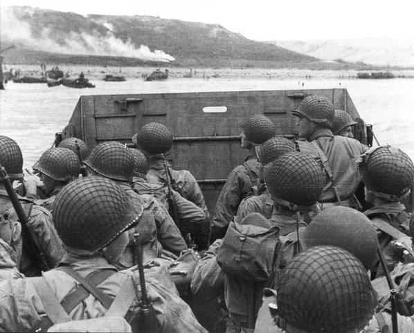 """British and US troops successfully land on the Normandy beaches of France, opening a """"Second Front"""" against the Germans."""