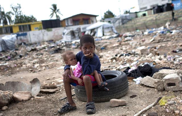Haitian Prime Minister Jean Max Bellerive Estimates Over 100,000 Dead from Earthquake