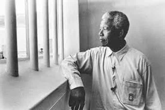 Nelson Mandela is imprisoned on charges of treason.