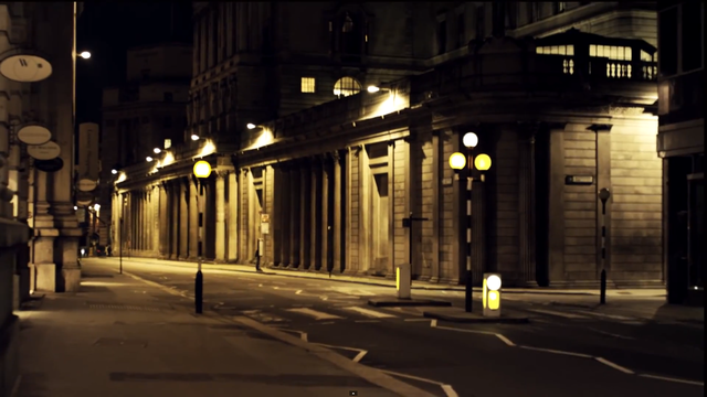 This wide shot makes the city setting of the video clear, the street lamps adding to the ambience of the urban setting.