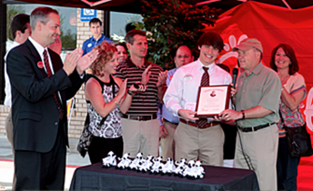 Truett Cathy creates the Team Member Scholarship Program so that restaurant employees can further his/her education