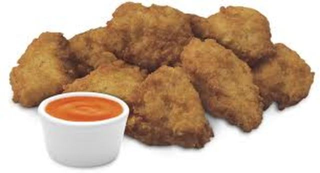 Introduces Chicken Nuggetys, and a new Chick-Fil-A office building is made