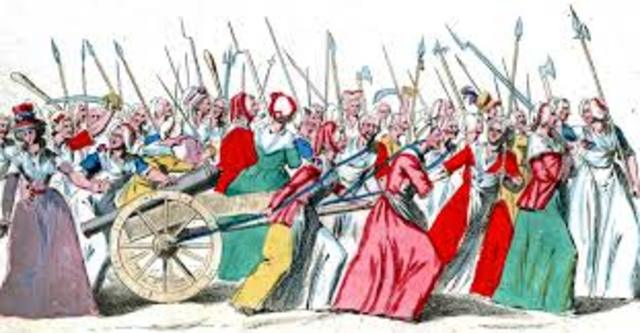Women march to Versailles and are joined by men to bring back royal family to Paris