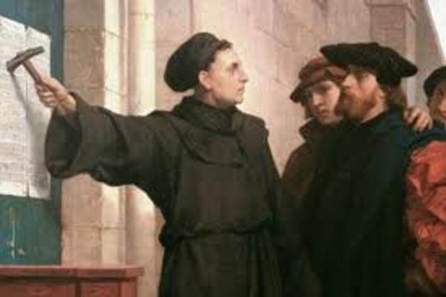 Martin Luther nails Ninety Five Theses to church in Germany