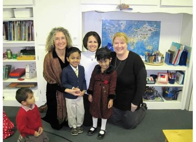 Sachita with her class teachers.