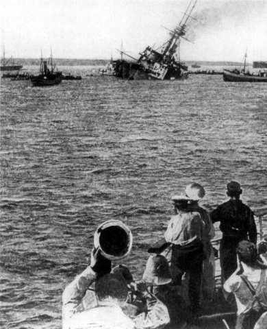Germany responds to U.S. anger by ceasing to sink ships without warning.