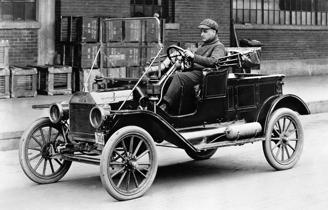 Henry Ford uses production line to produce the Model T