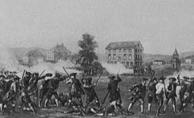British Army and American MIlitia exhange fire at Lexington, Massachusetts