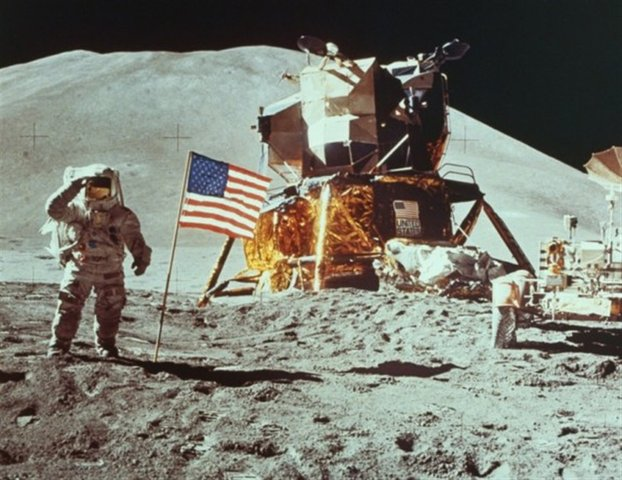 Neal Armstrong walks on moon; we see it on TV