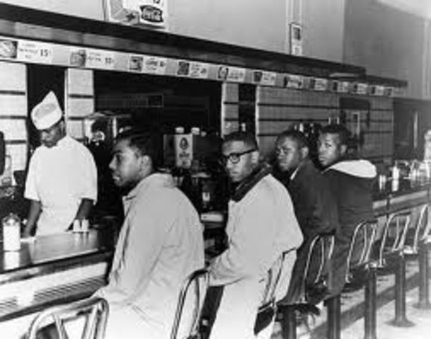 ,Four college students protested against segregation.
