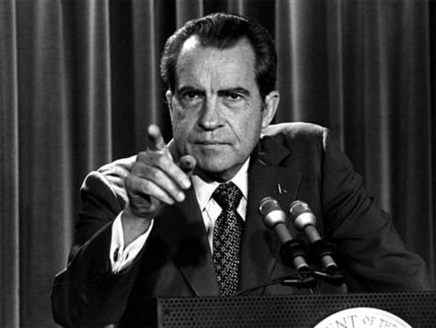 Richard Nixon resigns, a result of Watergate coverage