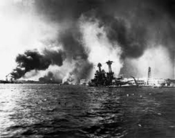 Japan attacks Pearl Harbor; which causes me and all of the US to declare war on Germany, Italy, and Japan.