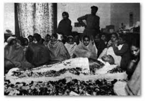 Gandhi is killed by several gun shots