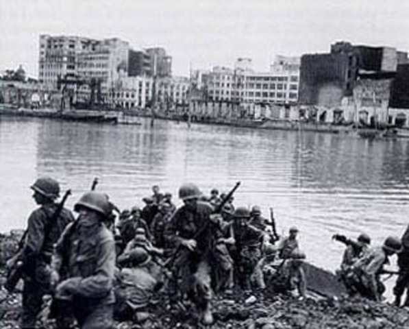 US troops land in the Philippines.