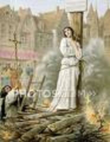 Joan dies by being burned at a stake at the Old Market place in Rouen.