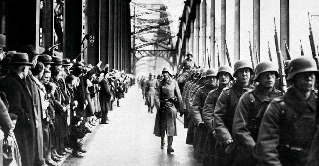 German troops march unopposed into the French-occupied Rhineland