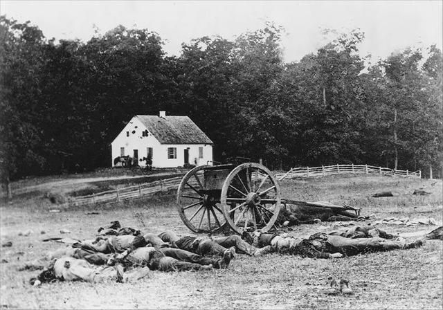 "9–43. Mathew Brady, ""Dunker Church and the Dead,"" 1862"
