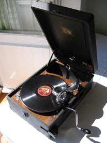 Compatible Stereo disks and record players are offered for sale (33 1/3 and 45rpm.)