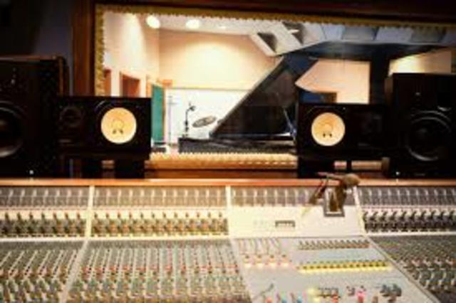 Multitrack analog tape recording starts being used in recording studios.