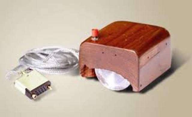 Douglas C. Engelbart demonstrates the first computer mouse (made of wood.)