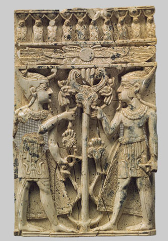 Egyptianizing figures on either side of a tree with a winged disk