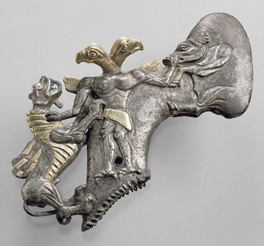 Shaft–hole axhead with a bird–headed demon, boar, and dragon