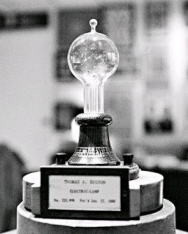 Edison perfects incandescent light bulb