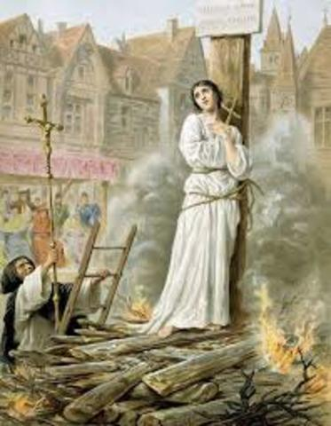 Joan of Arc burned at stake