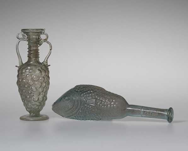 Bottle in the form of a fish and a flask in the form of grapes