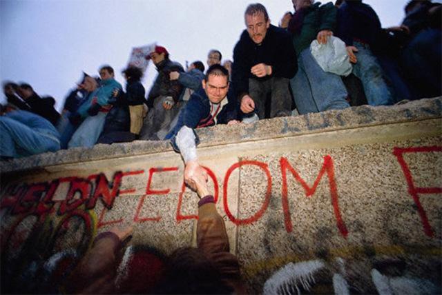 Berlin Wall falls in Germany.