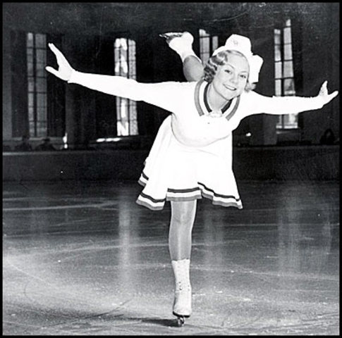 Sonja Henie wins 3rd consecutive Olympic figure skating gold.