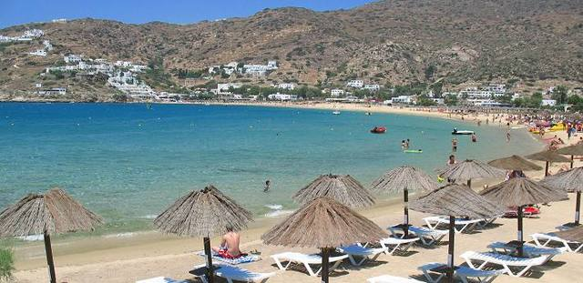 Take bus to Piraeus port from Athens airport.