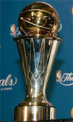 Hakeem is awarded the NBA Finals Most Valuable Player trophy