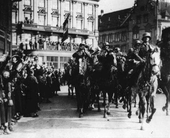 1936 Hitler sends troops into Rhineland of Germany in violation of the Versailles Treaty